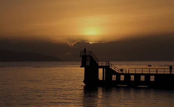 #galwaybay #galway #theprom #blackrock #salthill #ireland #travel #sunset #wildatlanticway #seascape #tourism #failteireland #sea #aranislands #silhouette #sun #irish #galwaygirl #tourism #landmark #divingboard #sundown Art Print featuring the photograph Sunset on Galway Bay by Rachel Dubber