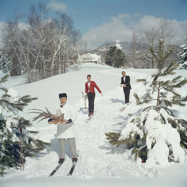 Skiing Art Print featuring the photograph Skiing Waiters by Slim Aarons