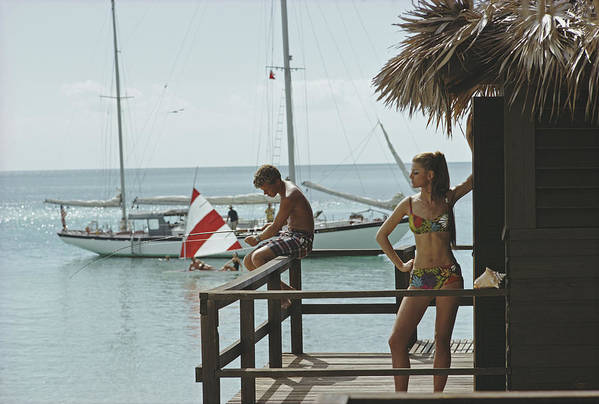 Beach Hut Art Print featuring the photograph Fishing On Honeymoon Porch by Slim Aarons