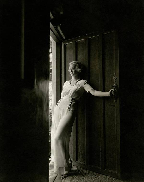 Bette Davis Standing In A Doorway by Maurice Goldberg