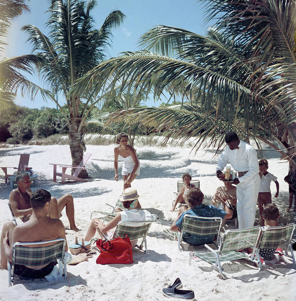 Afro-caribbean Ethnicity Art Print featuring the photograph Drinks On The Beach by Slim Aarons
