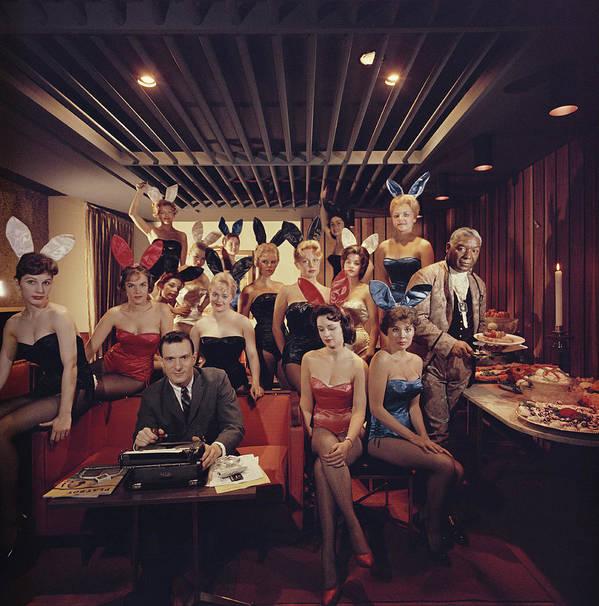 Hugh Hefner Art Print featuring the photograph Mans Work by Slim Aarons