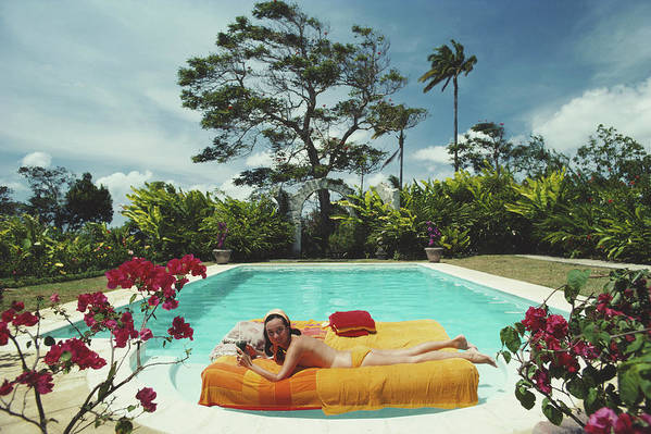 Artist Art Print featuring the photograph Sunbathing In Barbados by Slim Aarons