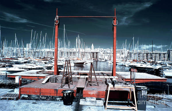 Boat Lift In The Port Art Print featuring the photograph Boat Lift In The Port by John Rizzuto