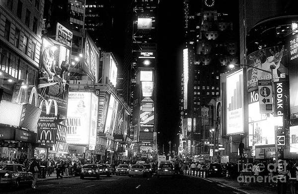Times Square At Night Art Print featuring the photograph Times Square At Night by John Rizzuto