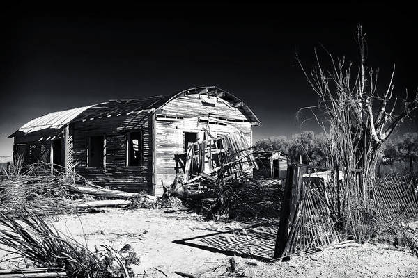 Deserted In The Desert Print featuring the photograph Deserted In The Desert by John Rizzuto