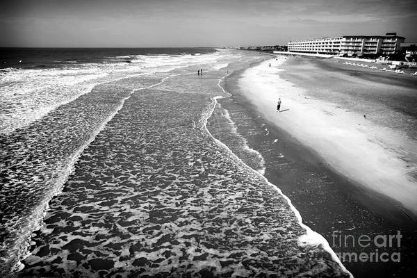 Jogging At Folly Beach Art Print featuring the photograph Jogging At Folly Beach by John Rizzuto