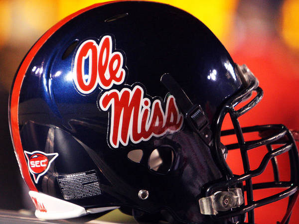 Ole Miss Art Print featuring the photograph Ole Miss Football Helmet by University of Mississippi