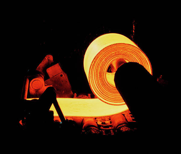 Red-hot Coil Of Sheet Steel In A Rolling Mill. by Rosenfeld Images Ltd/science Photo Library