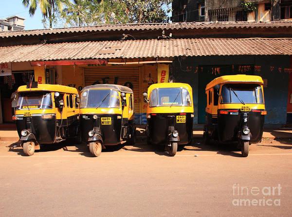 Line of auto rickshaws India by Deborah Benbrook