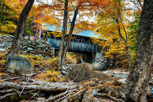 Fall colors over the Flume Gorge covered bridge by Jeff Folger