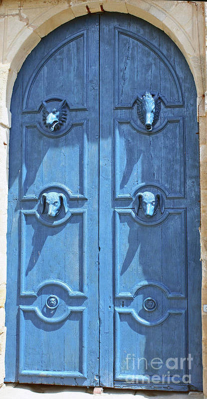 Blue Door Art Print featuring the photograph Blue Door Decorated With Wooden Animal Heads by Christiane Schulze Art And Photography