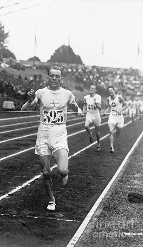 The Olympic Games Art Print featuring the photograph Paavo Nurmi Winning Olympic Track Race by Bettmann