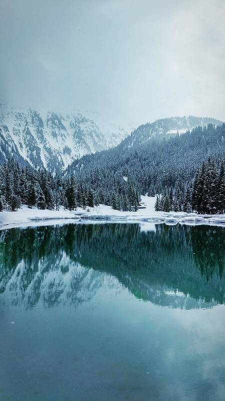 Tranquility Art Print featuring the photograph Reflection Of Mountains In Lake During Winter by Rmi Seznec / EyeEm