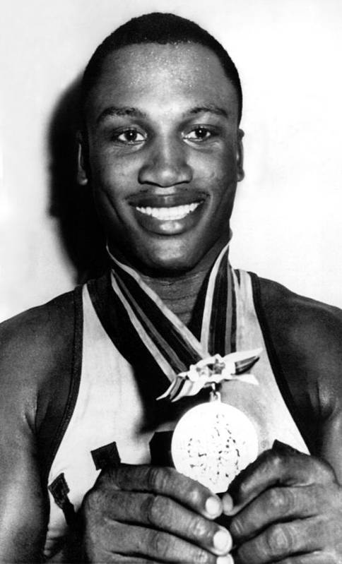 Boxer Art Print featuring the photograph Joe Frazier Holding Olympic Heavyweight by Everett