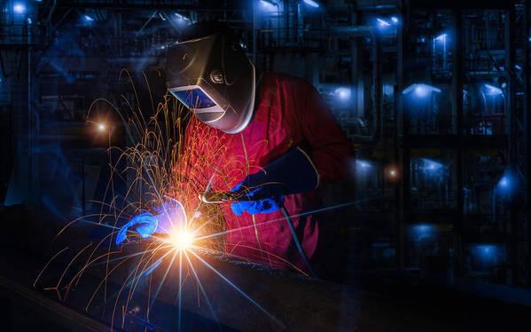 Worker Work Hard With Welding Process  by Anek Suwannaphoom