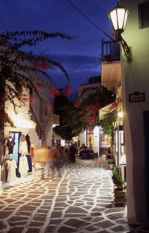 After Dark; ; Blur; Cyclades; Greece Art Print featuring the photograph Mykonos Town At Night by Steve Outram