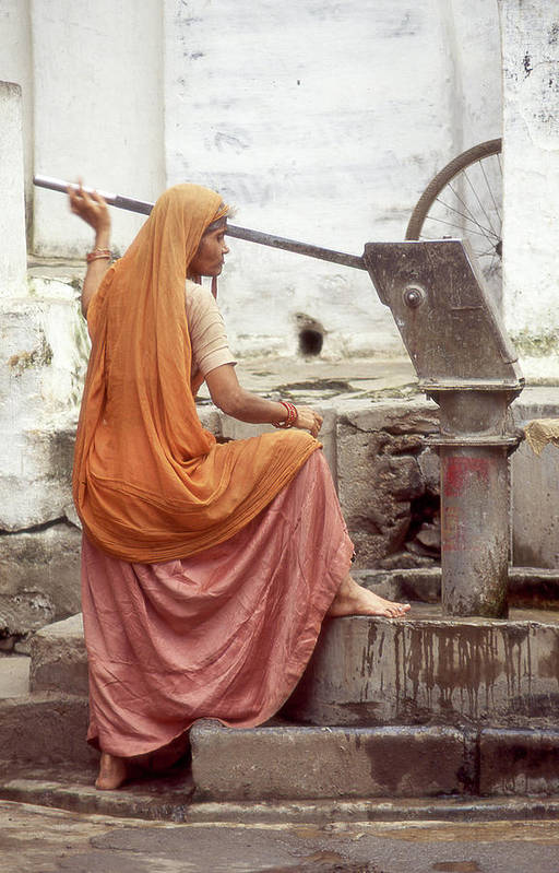 India Art Print featuring the photograph Woman At The Pump by Dray Van Beeck