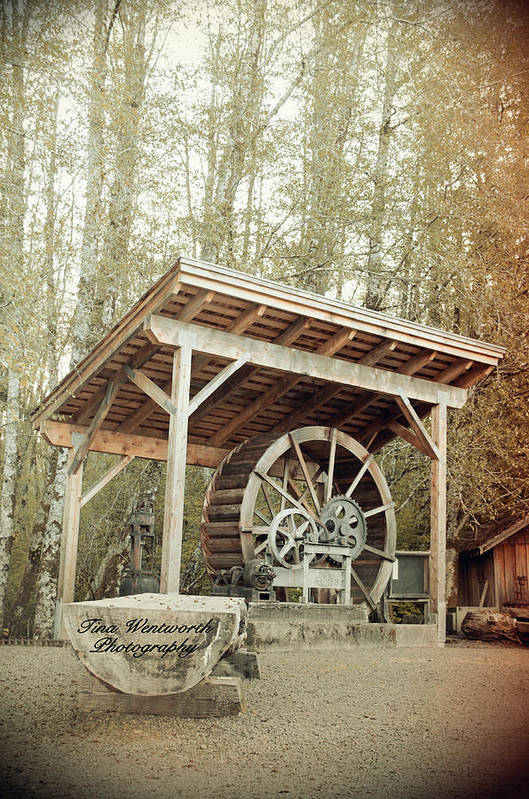 Antique Water Wagon Wheel Art Print featuring the photograph Antique Wagon Wheel by Tina Wentworth