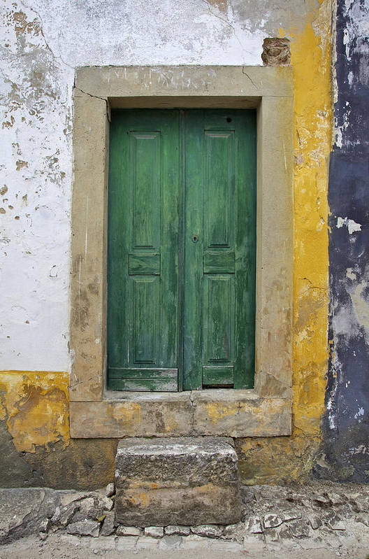 Art Print featuring the photograph Green Wood Door With Hand Carved Stone Against A Texured Wall In The Medieval Village Of Obidos by David Letts
