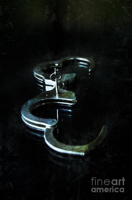 Handcuffs Art Print featuring the photograph Handcuffs On Black by Jill Battaglia