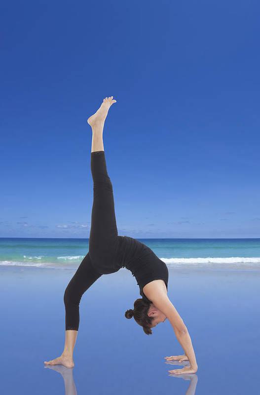 Action Art Print featuring the photograph Woman Doing Yoga On The Beach by Setsiri Silapasuwanchai