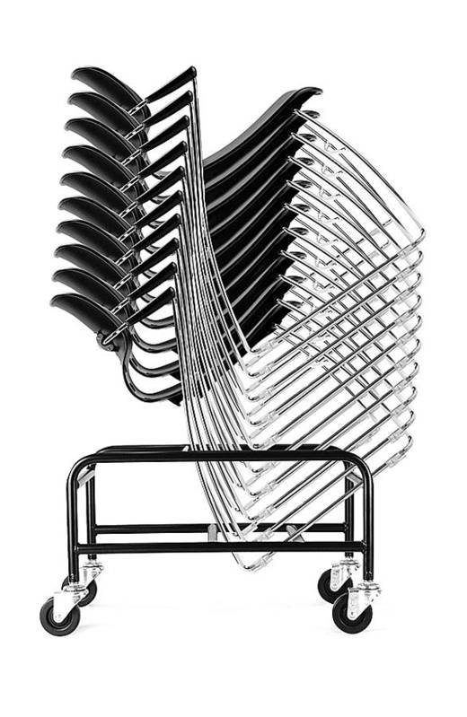 Chairs Black And White Art Print featuring the photograph Stacked Chairs by Alex Lemus