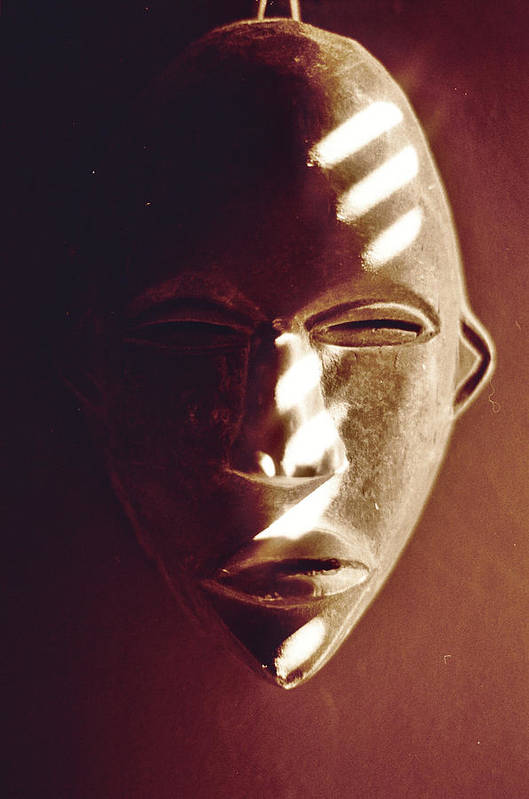 African Art Print featuring the photograph African Mask With Sunlight by Linnea Tober