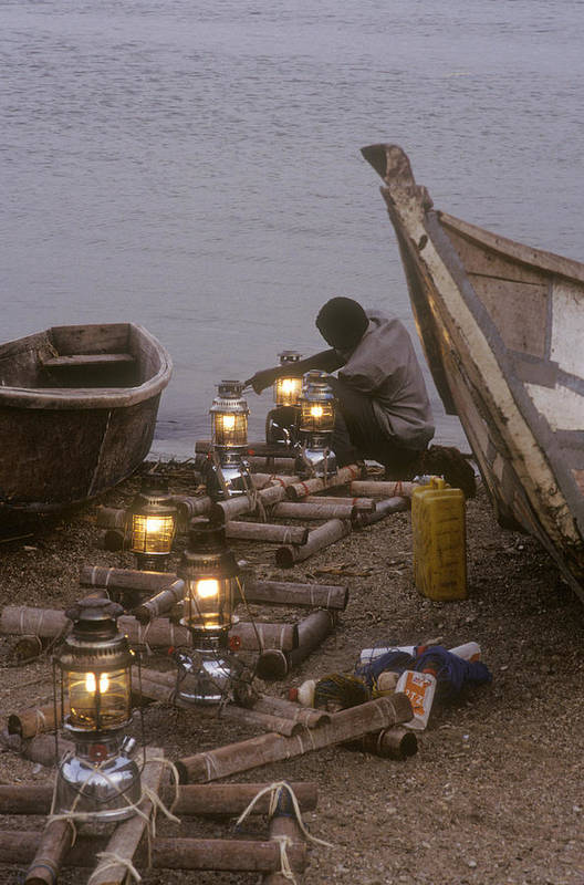 Uganda Art Print featuring the photograph Fisherman Prepares Lanterns For Night by Michael S. Lewis