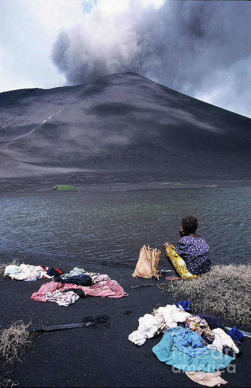 Active Volcano Art Print featuring the photograph Girl Washing Clothes In A Lake With The Mount Yasur Volcano Emitting Smoke In The Background by Sami Sarkis