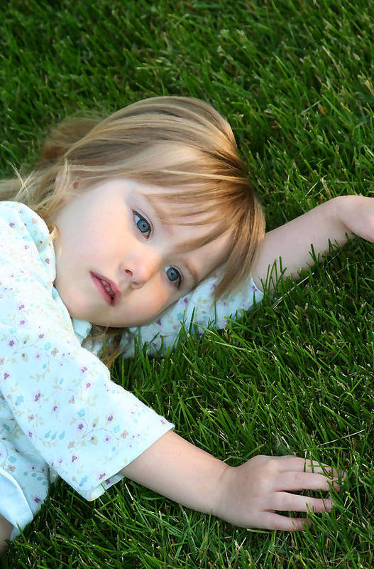 Girl Art Print featuring the photograph Lying In The Grass by Margie Wildblood