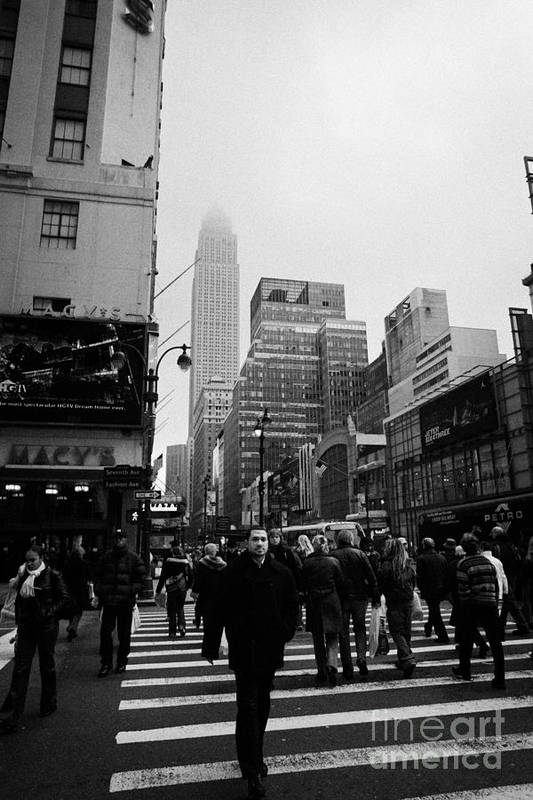 Usa Print featuring the photograph Pedestrians Crossing Crosswalk Outside Macys 7th Avenue And 34th Street Entrance New York Winter by Joe Fox