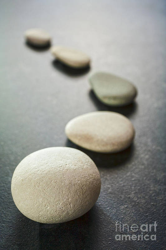 Stone Art Print featuring the photograph Curving Line Of Grey Pebbles On Dark Background by Colin and Linda McKie