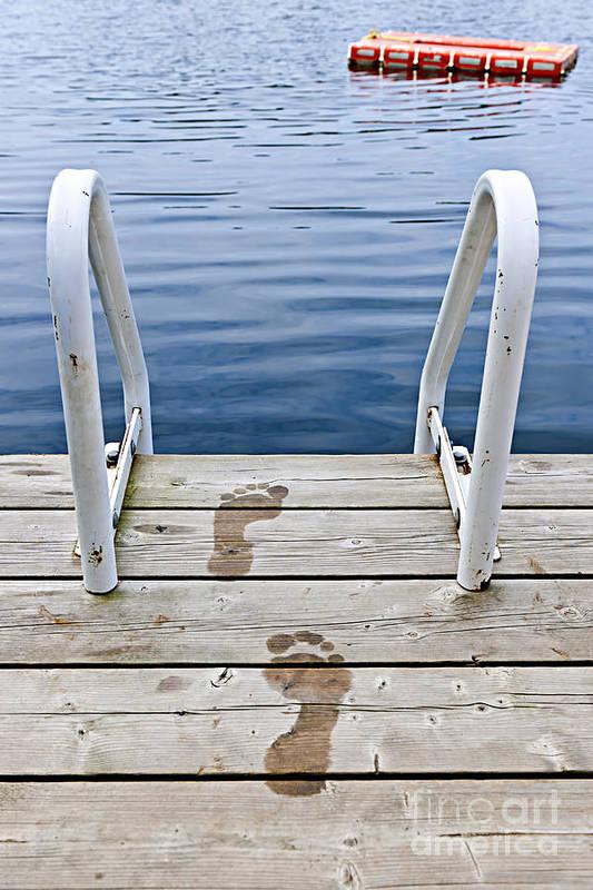 Footprints Art Print featuring the photograph Footprints On Dock At Summer Lake by Elena Elisseeva
