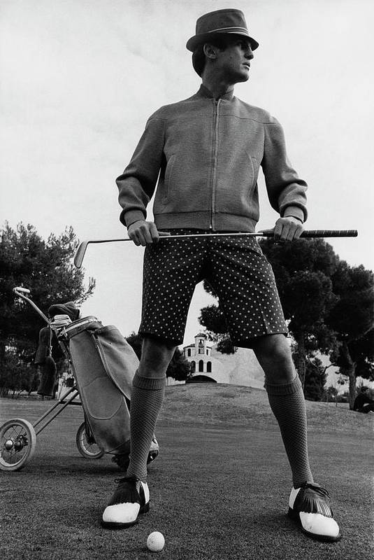 Menswear Art Print featuring the photograph A Male Model Posing As A Golfer Wearing by Leonard Nones