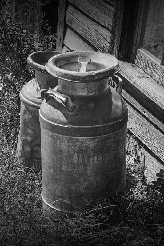 Creamery Can Art Print featuring the photograph Black And White Old Prairie Homestead Vintage Creamery Cans Near The Badlands by Randall Nyhof