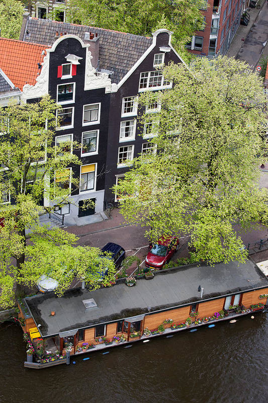 Amsterdam Art Print featuring the photograph Canal Houses And Houseboat In Amsterdam by Artur Bogacki