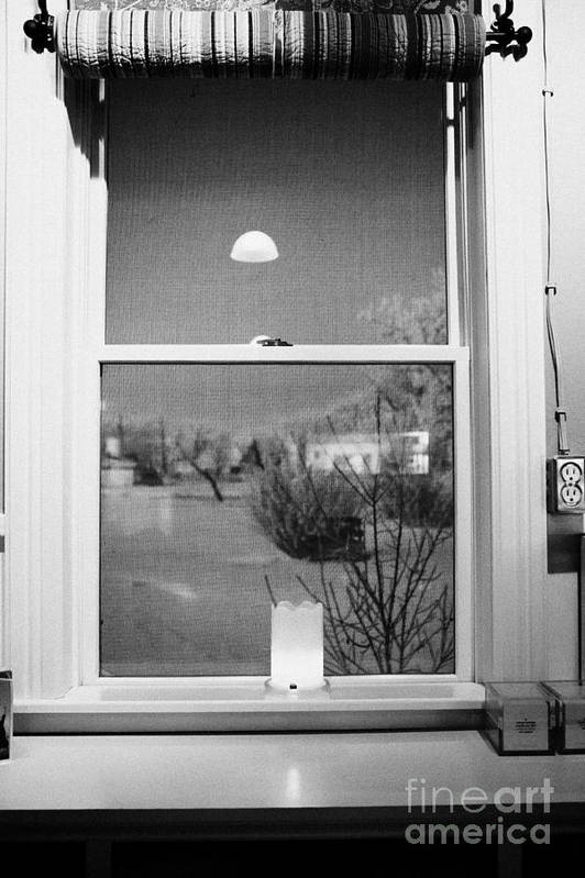 Looking Art Print featuring the photograph Candle In The Window Looking Out Over Snow Covered Scene In Small Rural Village by Joe Fox
