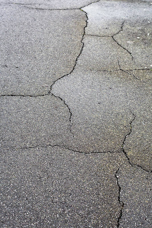Abstract Print featuring the photograph Cracked Tarmac by Tom Gowanlock