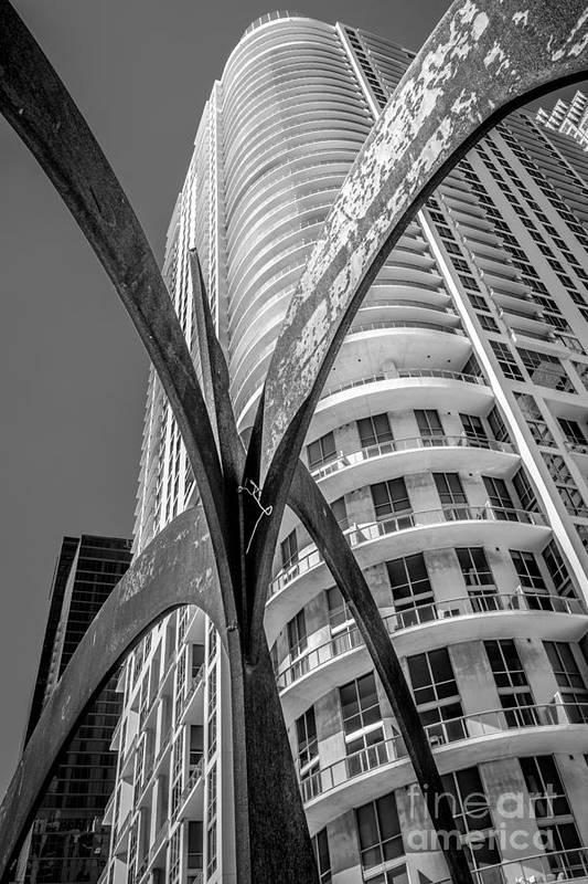 2003 Art Print featuring the photograph Element Of Duenos Do Los Estrellas Statue With Miami Downtown In Background - Black And White by Ian Monk