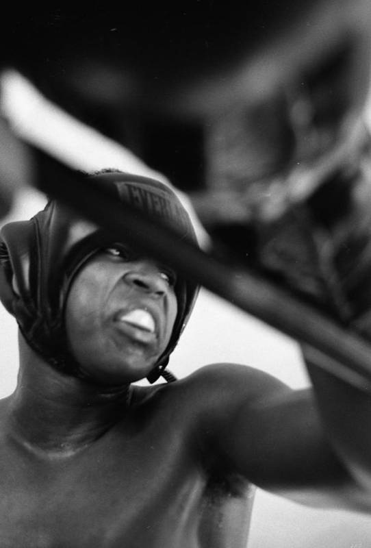 Marvin Newman Print featuring the photograph Muhammad Ali Looking Sideway Through Rope by Retro Images Archive