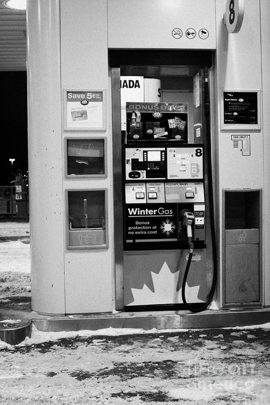 Petrol Art Print featuring the photograph petro canada winter gas fuel pump at service station Regina Saskatchewan Canada by Joe Fox