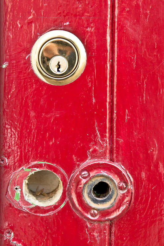 Anti-theft Art Print featuring the photograph Red Door Lock by Tom Gowanlock