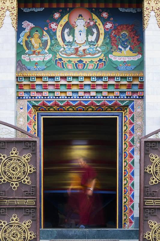 Buddha Art Print featuring the photograph Tibetan Monk And The Prayer Wheel by Tim Gainey
