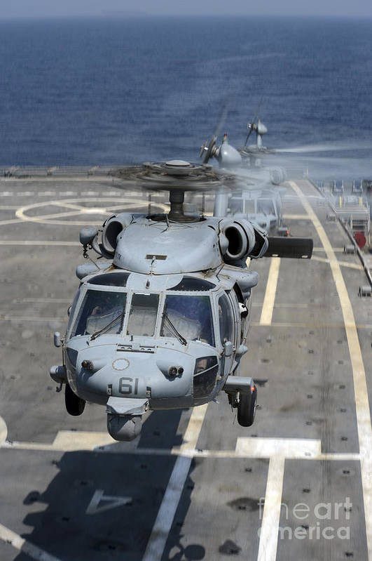 Military Print featuring the photograph Two Mh-60s Sea Hawk Helicopters Take by Stocktrek Images