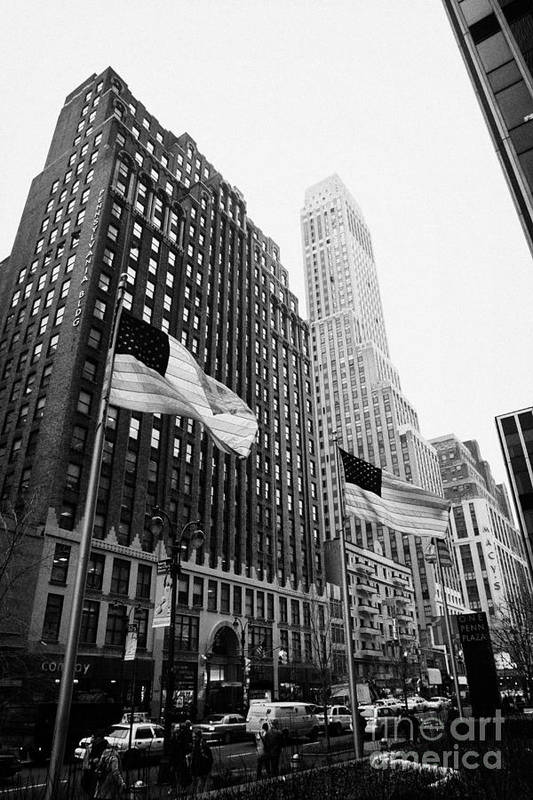 Usa Art Print featuring the photograph view of pennsylvania bldg nelson tower and US flags flying on 34th street new york city by Joe Fox