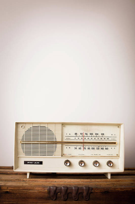 Desaturated Art Print featuring the photograph Vintage Beige Radio Sitting On Wood by Ideabug