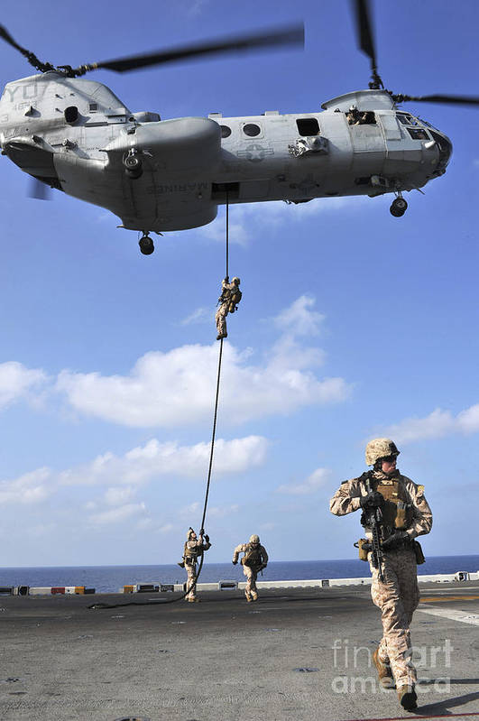 Warship Art Print featuring the photograph Marines Fast Rope From A Ch-46e Sea by Stocktrek Images