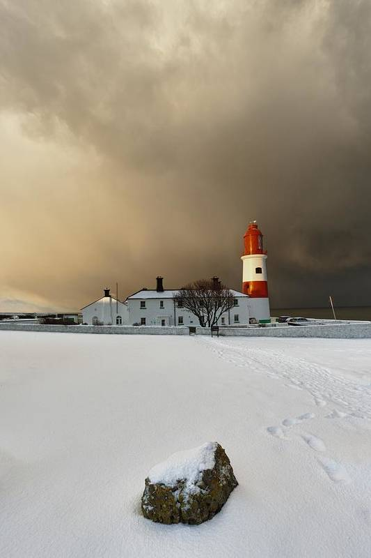 Building Art Print featuring the photograph A Lighthouse And Building In Winter by John Short