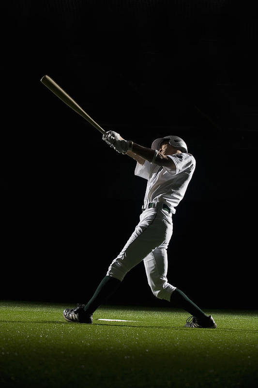 25-29 Years Art Print featuring the photograph Baseball Batter Swinging Bat, Side View by PM Images